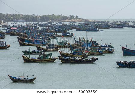 Mui Ne, Vietnam - January 15, 2015: Fishing village and colorful fishing boats near Mui Ne at a sunny day. Vietnam