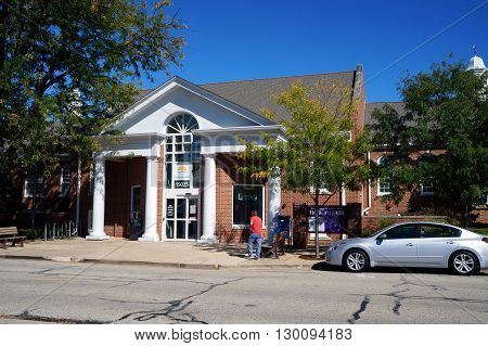 PLAINFIELD, ILLINOIS / UNITED STATES - SEPTEMBER 20, 2015: One may borrow books at the Plainfield Public Library in downtown Plainfield.