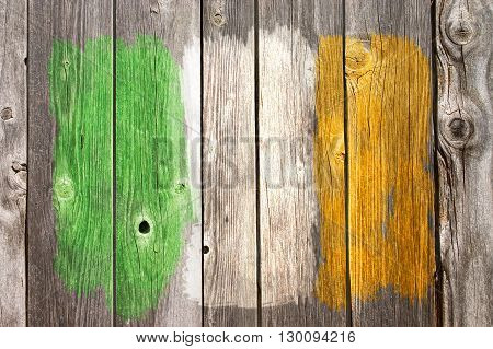irish colors painted on old wooden wound