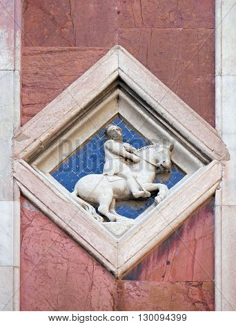 FLORENCE, ITALY - JUNE 05: Mars by Collaborator of Andrea Pisano, 1337-41., Relief on Giotto Campanile of Cattedrale di Santa Maria del Fiore, Florence, Italy on June 05, 2015