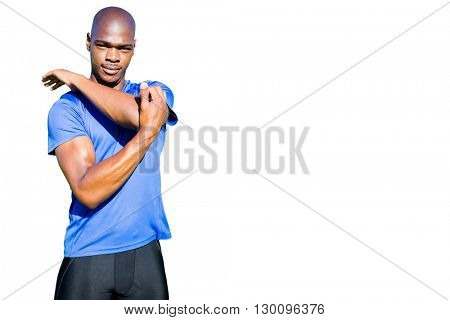 Athletic man stretching his arms