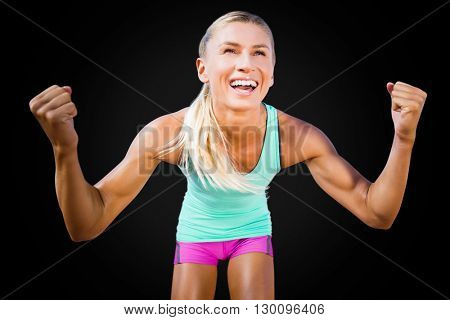 Portrait of sportswoman smiling and raising arms