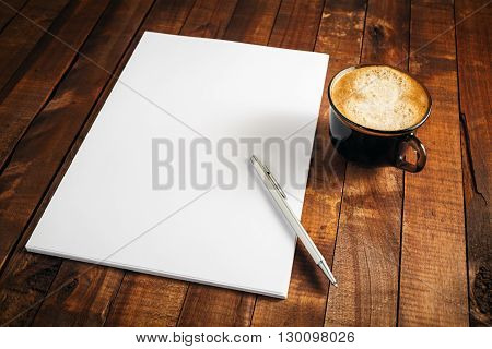 Blank letterhead coffee cup and pen. Blank branding template. Photo of blank stationery. Mock-up for design presentations and portfolios.