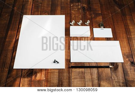 Photo of blank stationery set. Blank stationery template for branding identity for designers. Letterhead business cards badge envelope and pencil.