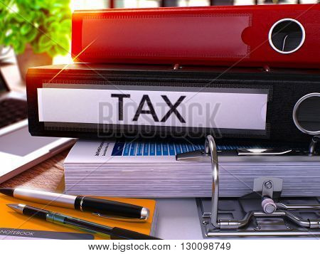 Black Office Folder with Inscription Tax on Office Desktop with Office Supplies and Modern Laptop. Tax Business Concept on Blurred Background. Tax - Toned Image. 3D.