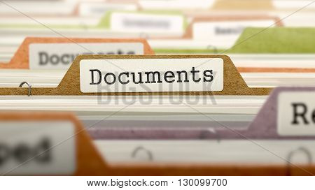 Documents on Business Folder in Multicolor Card Index. Closeup View. Blurred Image. 3D Render.