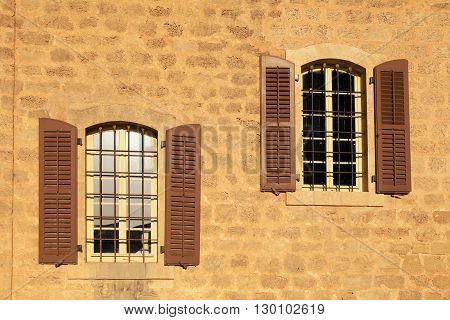 two old windows with shutters in stone wall, Jaffa, Tel Aviv, Israel.