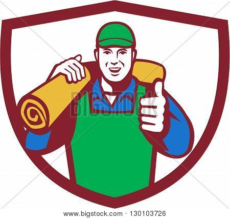 Illustration of a male carpet layer smiling with thumbs up and carrying roll of mat carpet on shoulder viewed from front set inside shield crest done in retro style.