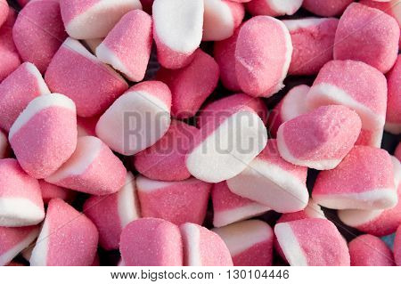 Collection of white and pink gummy candies
