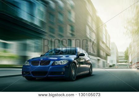 Moscow, Russia - May 10, 2015: Blue car BMW 5 series E90/E91 Fast speed drive on city road