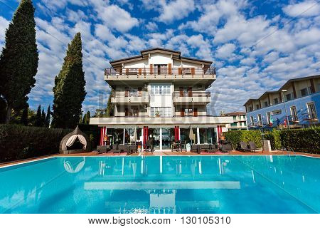 Sirmione Italy - May 03 2016: View of the Alexandra Stay resort against the beautiful cloudscape on the background