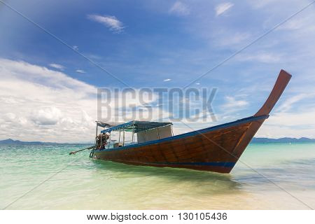 Long Tail Boat at tropical White Sand Beach Trang near Phuket Thailand