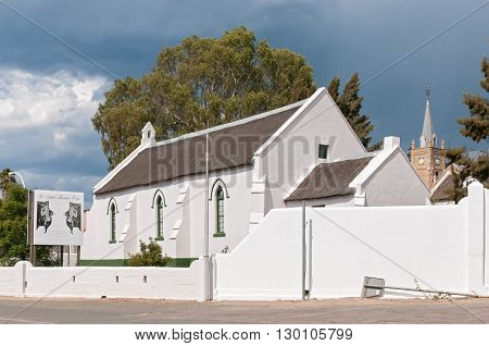 UNIONDALE SOUTH AFRICA - MARCH 5 2016: The Pinkster Protestant Church in Uniondale originally built by the London Missionary Society circa 1843. The Little Theatre Cafe is behind the church