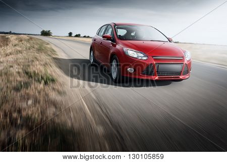 Saratov, Russia - September 21, 2014: Red car Ford Focus III Sport fast speed driving on the asphalt road at daytime