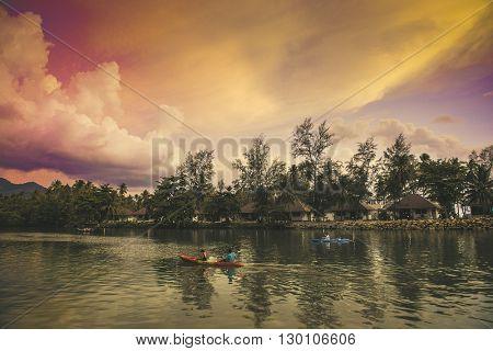KO CHANG, THAILAND - MAY 07, 2016: Sunset. Fishing boat and kayak in the sea