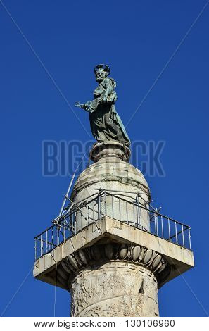 Bronze statue of St Peter at the top of Trajan Column in the historic center of Rome