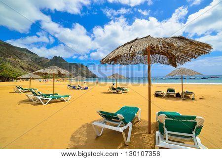 Umbrellas and chairs on Teresitas beach in Tenerife village - Spain