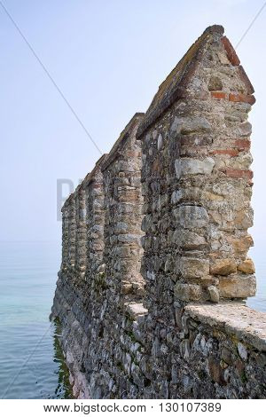 big ancient fortress or stone fort on sea space and a blank space