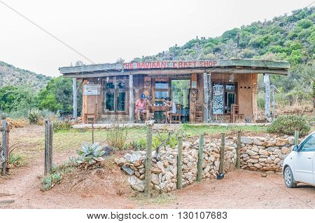 BAVIAANSKLOOF SOUTH AFRICA - MARCH 5 2016: Unidentified tourists at a coffee shop and craft centre in the Baviaanskloof (baboon valley). Falling rain is visible