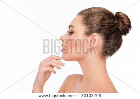Side View Of Pretty Woman Touching Chin On White Background