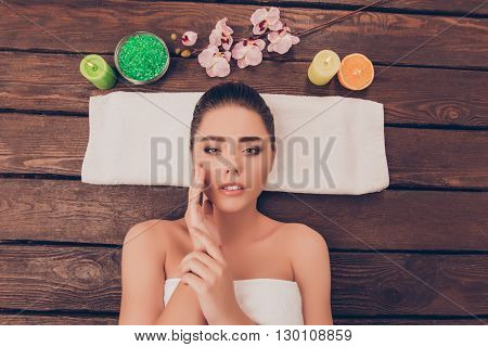 Sensual Woman With Perfect Skin Relaxing In Sauna With Candles