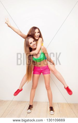 Happy Pretty Young Woman Piggybacking Her Cheerful Sister