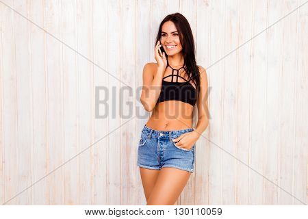 Slender Young Smiling Woman Talking On Mobile Phone