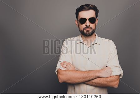 Portrait Of Brutal Sexy Man In Glasses With Crossed Hands