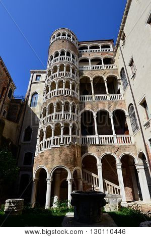 VENICE, ITALY - JULY 31: Beautiful renaissance spiral staircase in the center of Venice one of the most famous tourist attraction in the city JULY 31 2015 in Venice, Italy
