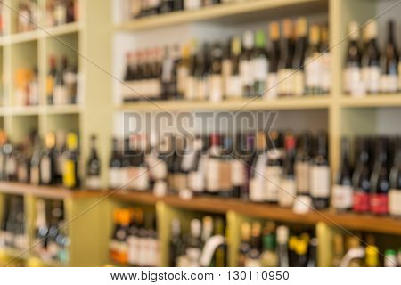 Blurred image of bottles of wine on shelves of a storehouse