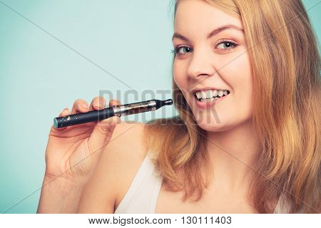 Pretty girl smoking electronic cigarette. Addicted nicotine problems in young age. Addiction concept.
