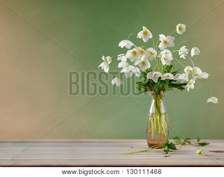 Bouquet of white Adonis in a glass vase. Spring bouquet. Spring bouquet of white flowers