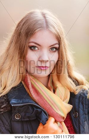 Portrait of pretty attractive fashionable woman in fall forest park. Gorgeous blonde young girl in jacket. Autumn winter fashion.