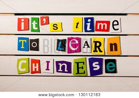 It's time to learn chinese - written with color magazine letter clippings on wooden board. Chinese language learning.