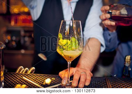 Barmen preparing coctail with mint and champaign