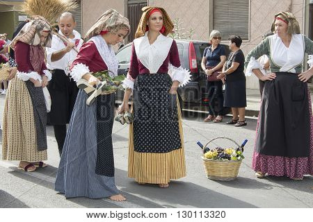 QUARTU S.E., ITALY - September 15, 2013: Wine Festival in honor of the celebration of St. Helena - Sardinia - group of women in traditional Sardinian costumes