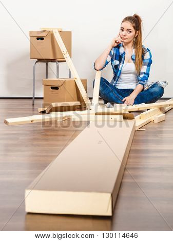 Woman Moving In With Screws And Furniture Parts