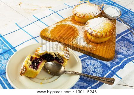 Sweet pie on the white plate. Sweet dessert. Sweet pastry. Small pie. Pie. Jam pie