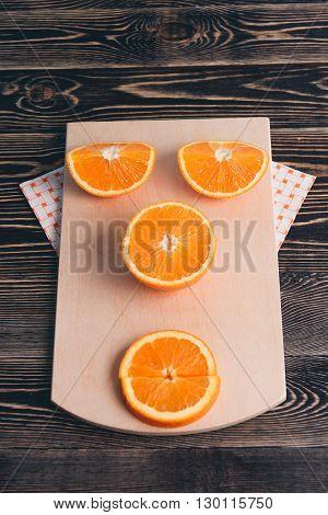 Orange, Half of Orange, Orange Lobule on the Wooden Table. Healthy Lifestyle Concept