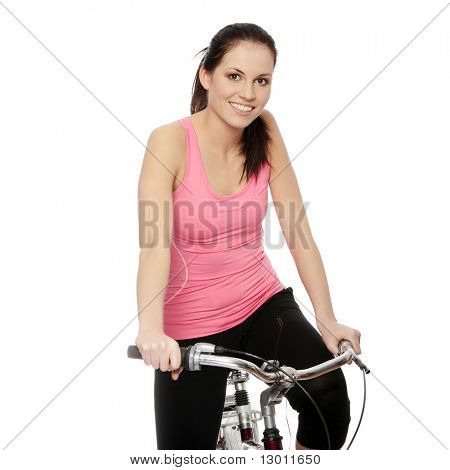 Attractive brunette woman with bike. over white background