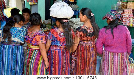 CHICHICASTENANGO GUSTEMALA APRIL 29 2016: Portrait of a colored dress Mayan women. The Mayan people still make up a majority of the population in Guatemala,