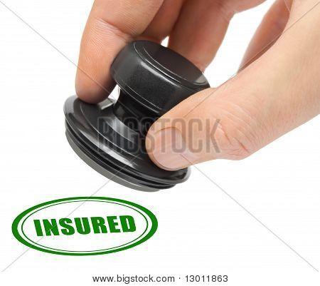 Hand and stamp Insured