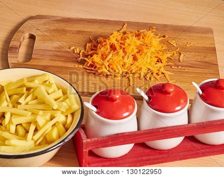 Grated Carrots On Table. Potatoes In  Plate