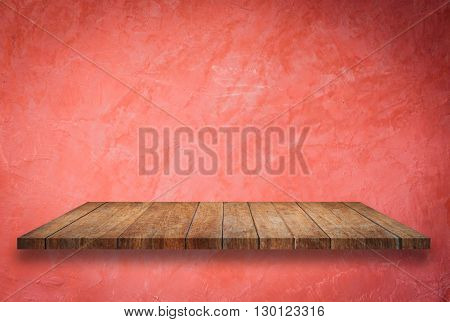 Empty perspective top wooden shelf on red wall background