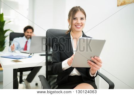 Businesswoman using a tablet computer in her office