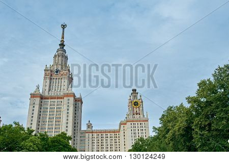 Lomonosov Moscow State University with trees and sky