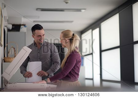 happy business people group at modern office copy  documents on machine