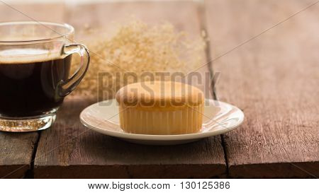 butter cake with hot coffee cup on the table