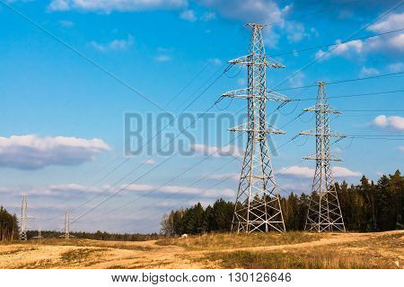 power line against the sky with clouds