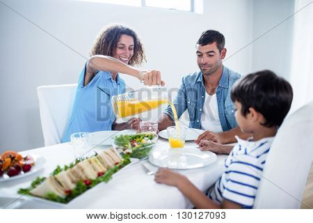 Family having breakfast together at home